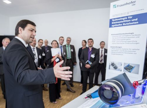 Prof. Schäfer explaining one of 70 exhibits by Fraunhofer